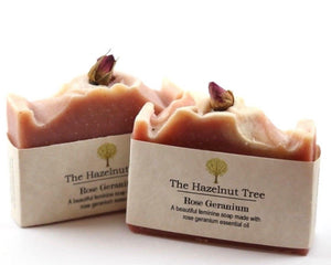 2x pink soaps with a dried rose on top