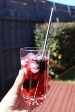 Load image into Gallery viewer, red beverage in glass cup with steel straw