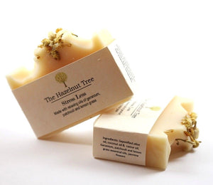 2x pale yellow soaps with dried jasmine flowers on top
