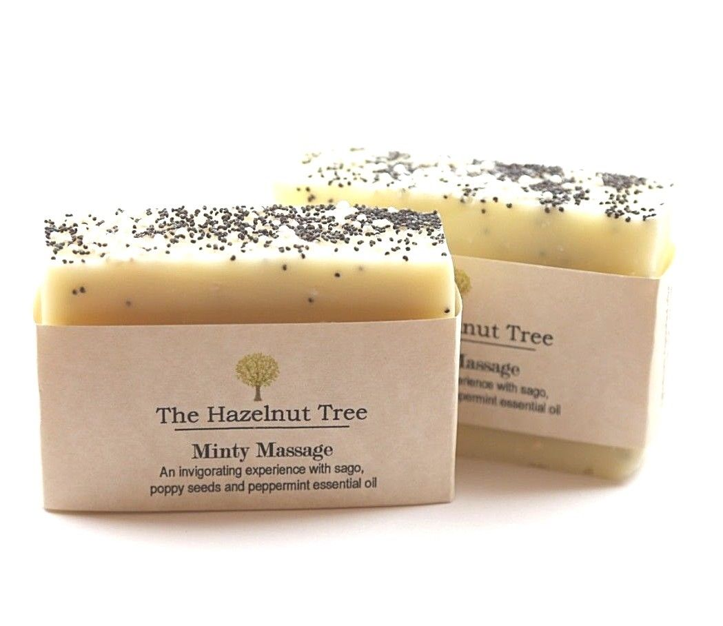 2x pale yellow soaps with poppyseeds embedded in the top for exfoliating