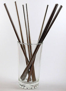 multiple steel straws in glass cup