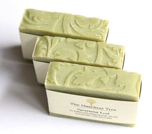 Load image into Gallery viewer, birds eye of 3 pale green soaps with a leaf shape texture imprinted on top
