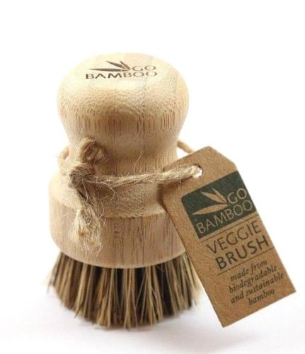 single brush with short handle and firm bristles designed for scrubbing hard surfaces