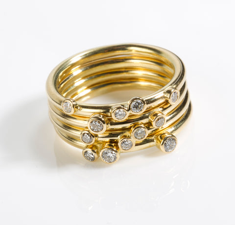 Gold and diamond scatter ring