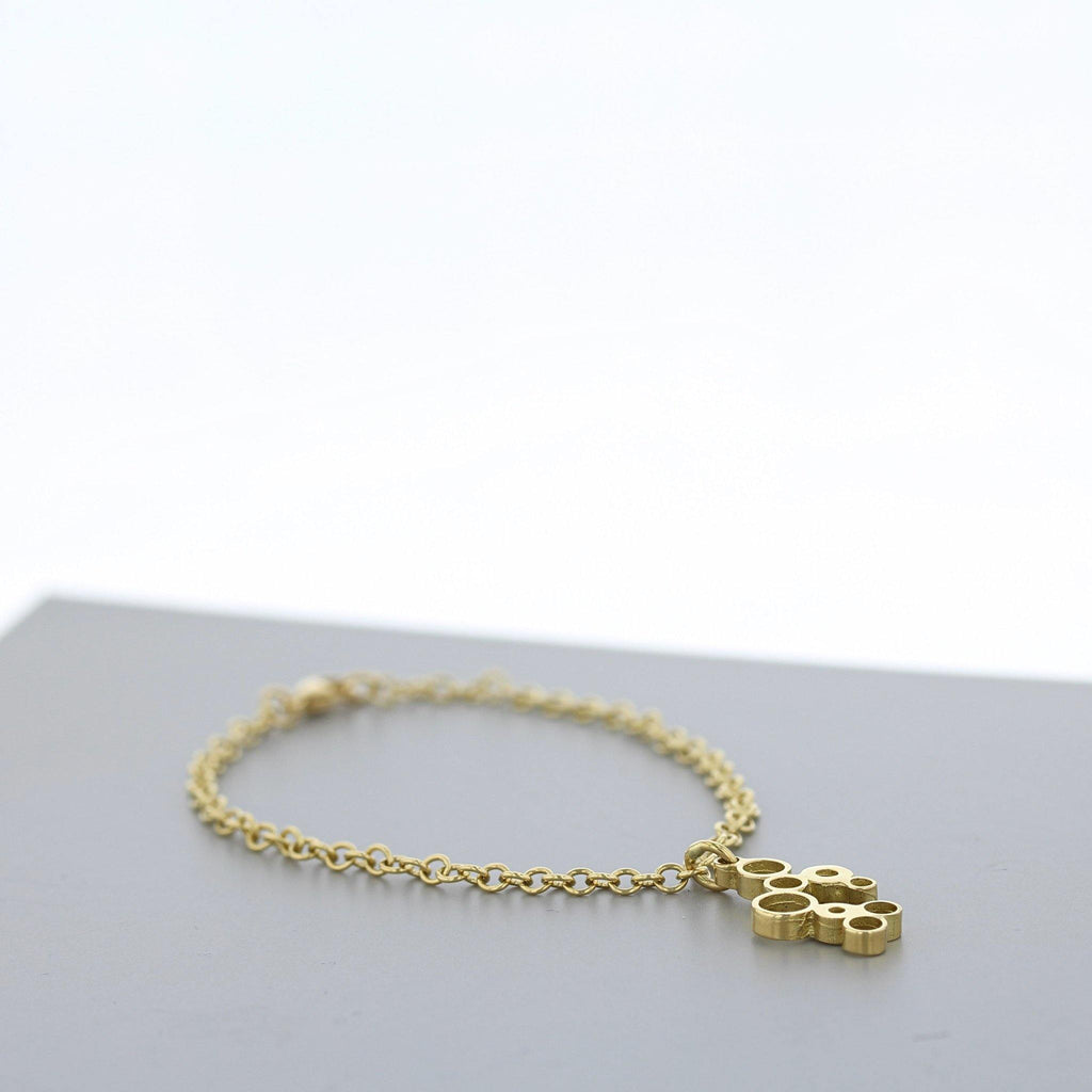 Bubbles: charm bracelet, 18ct yellow gold