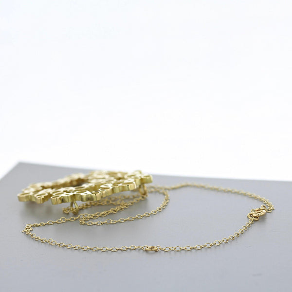 Bubbles: medium pendant, 18ct yellow gold