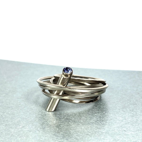 Solitaire: 18ct white gold and tanzanite ring - size O/P