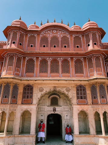 city palace in jaipur with two gaurds