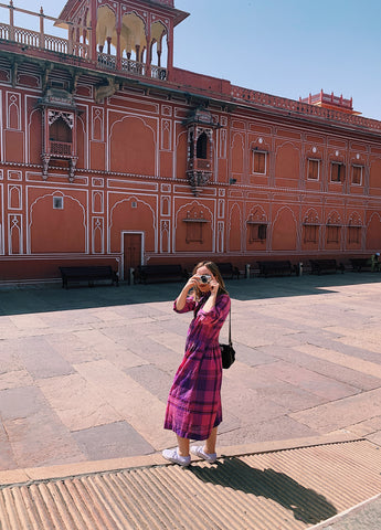lily parkinson taking a photo at jaipur city palace