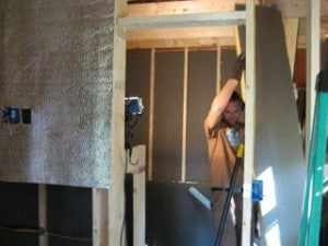 Doug insulating the Seed House.