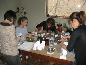 Friends and helpers Kate, Linda-Brook, Aileah, and Erin wind down a seed-packing marathon.