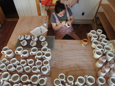 Ayumi drawing on pots.