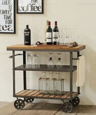 Country style recycled wood antique bar cart on wheels.