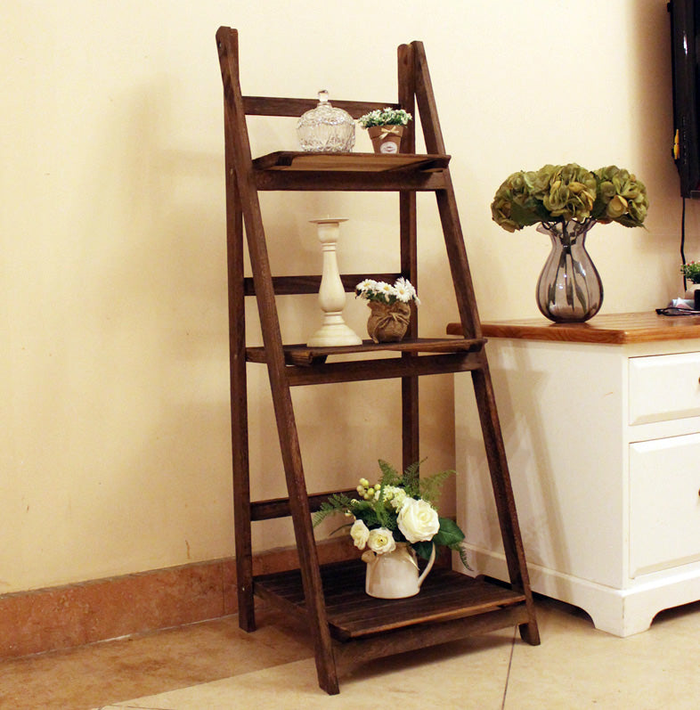 Rustic rack ladder made of carbonized wood.