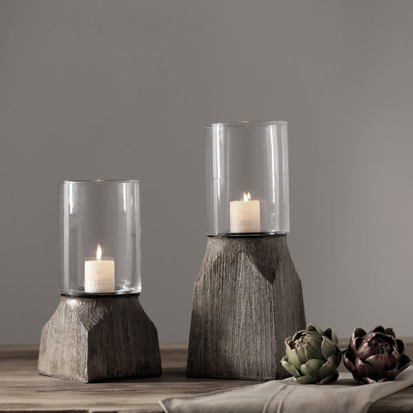 Rustic candlestick with candle.