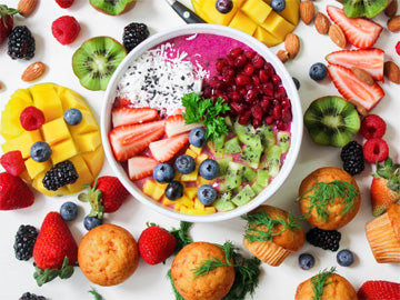 colorful fruits and vegetables in a white bowl