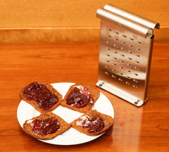 French rye toast with butter and jam in front of The Nicer Slicer