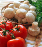 Tomatoes, mushrooms and herbs on cutting board