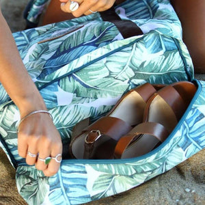 brown leather shoes stored in the bottom shoe compartment of the salt atlas drifter tote bag in island green print
