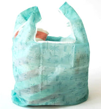 Load image into Gallery viewer, beach towel inside the salt atlas foldable eco bag in surfy print