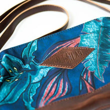 Load image into Gallery viewer, front of the salt atlas rover crossbody bag in blue lily print