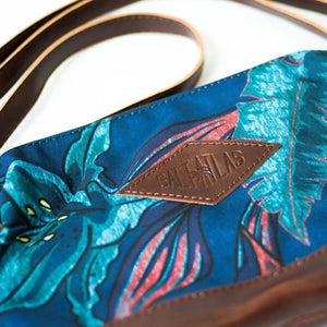 front of the salt atlas rover crossbody bag in blue lily print