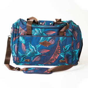front view of the salt atlas voyager duffle in blue lily print