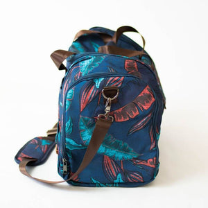 side view of the salt atlas voyager duffle in blue lily print