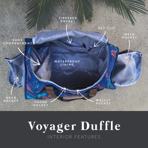 diagram showing the zippered pocket, key clip, mesh pocket, wallet pocket, phone pocket, shoe compartment, and waterproof lining of the salt atlas voyager duffle in blue lily print.