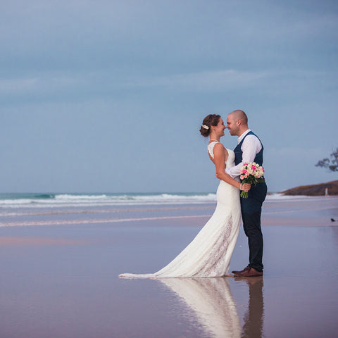 Wedding Photography on North Stradbroke Island Straddie by Julie Sisco. A newly married couple embrace at the beach for the bridal portraits