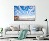 Coastal scene wall art canvas on the wall with a living room couch