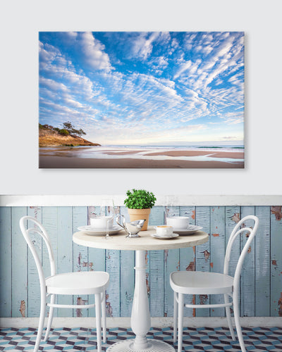 beautiful beach scene wall art canvas on the wall in a rustic coastal cafe