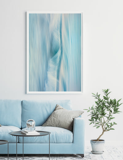 blue toned abstract wall art photographic piece by Julie Sisco North Stradbroke Island elemental with a blue couch and indoor plant living room