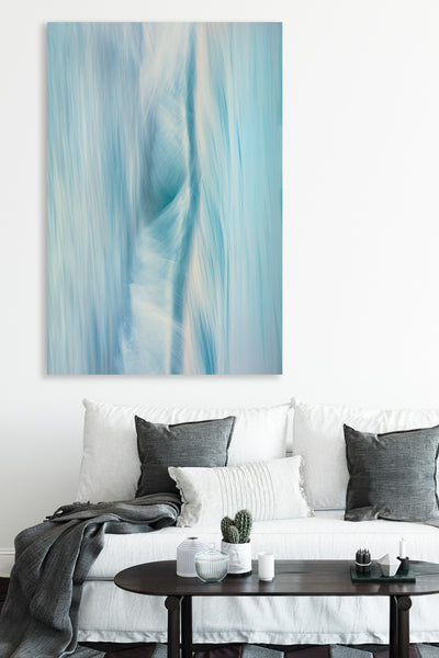 blue toned abstract wall art photographic piece by Julie Sisco North Stradbroke Island elemental with a white couch and dark grey cushions upmarket
