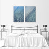 modern wall art prints of blue water ocean ripples on the wall in a bedroom
