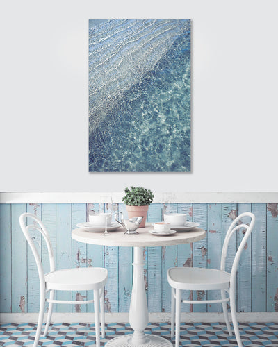modern wall art print of blue water ocean ripples on the wall in a cafe