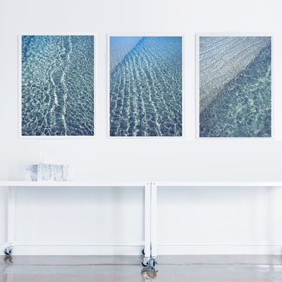 modern wall art triptych prints of blue water ocean ripples on the wall in a room