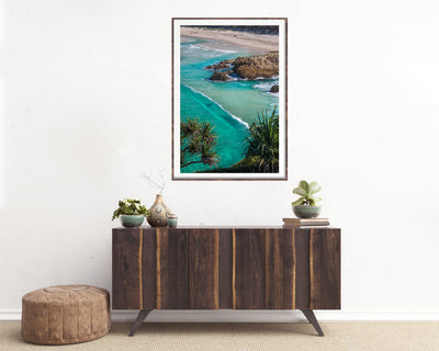 framed wall art photograph of South Gorge on North stradbroke Island on the wall above a buffet sideboard cupboard
