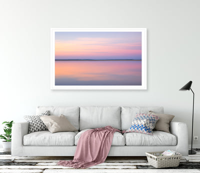 living room with framed wall art print of pastel pink abstract image of still calm waters at sunset on North Stradbroke Island