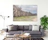 wall art featuring paperbark trees at Home Beach on North Stradbroke Island on the wall in a living room with a grey couch