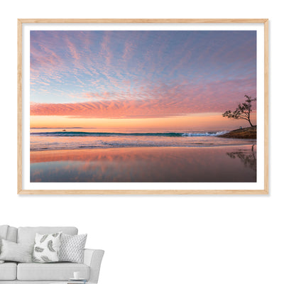 A beautiful sunset wall art print of Adder Rock with a kayaker photographed at Stradbroke Island by Julie Sisco