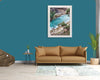 a living room featuring a wall art print of a pandanus palm and the ocean at North Gorge North Stradbroke Island