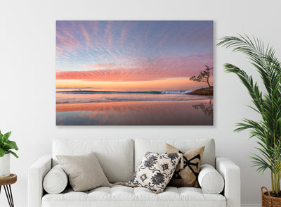 A lounge with A beautiful sunset wall art print of Adder Rock with a kayaker photographed at Stradbroke Island by Julie Sisco