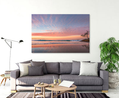 A living room featuring A beautiful sunset wall art print of Adder Rock with a kayaker and fishermen photographed at Stradbroke Island by Julie Sisco