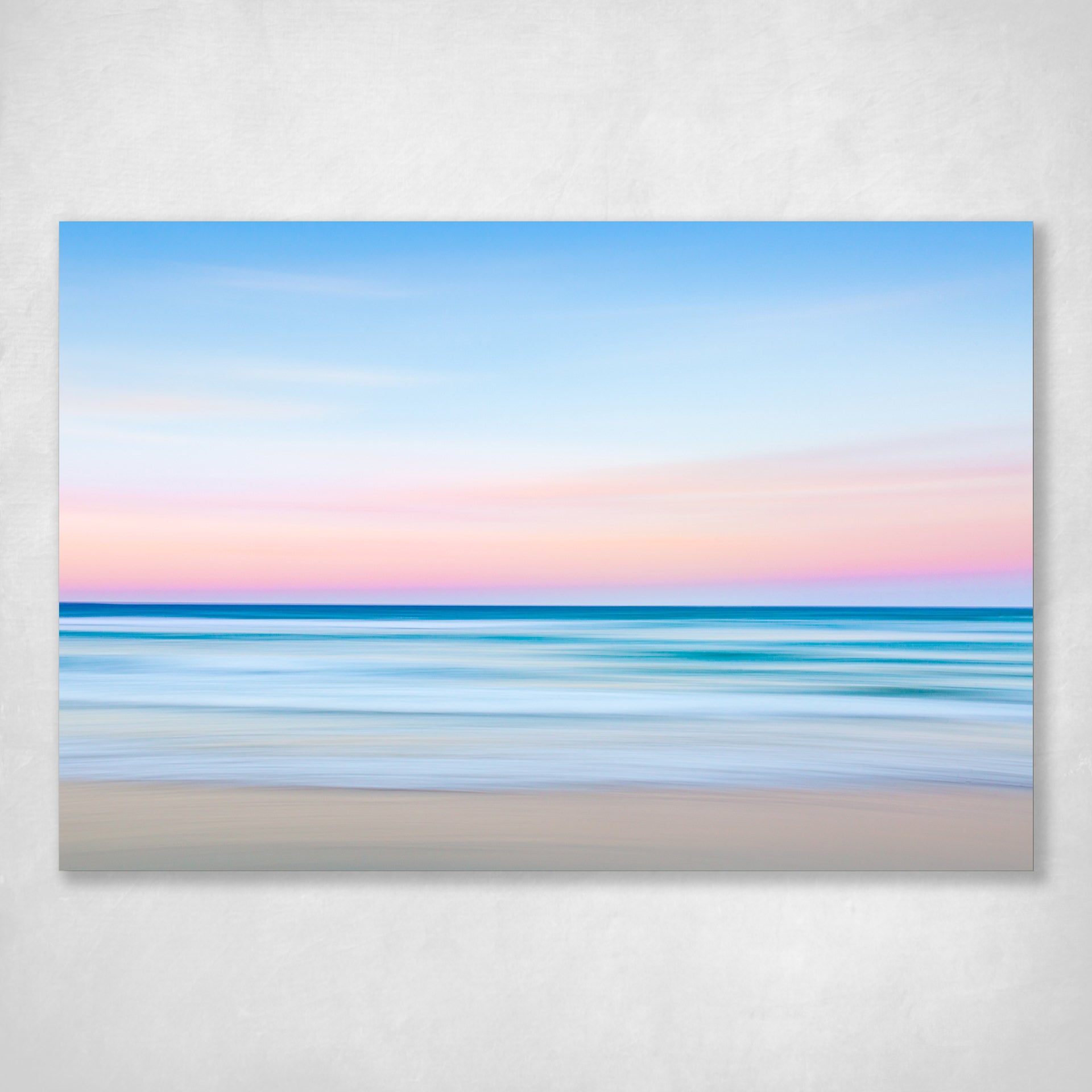 blurred lines of ocean and sunset sky abstract photograph pinks blues by julie sisco photography stradbroke