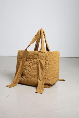 Gold quilted tote bag