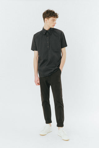 Black elasticated pants with asymetrical side pockets