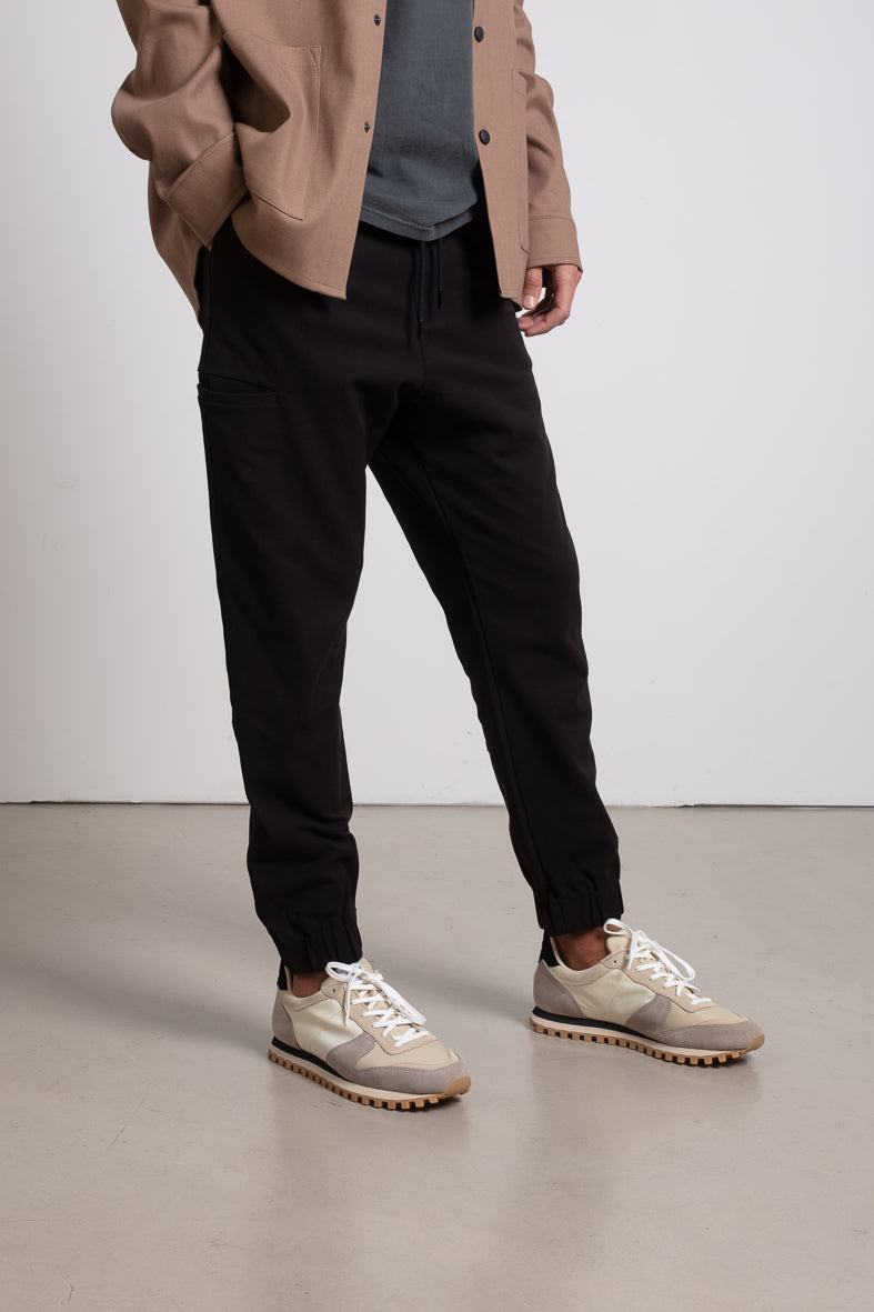 Black pants with asymmetrical side pockets