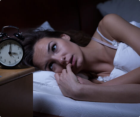 Image of woman unable to fall asleep.