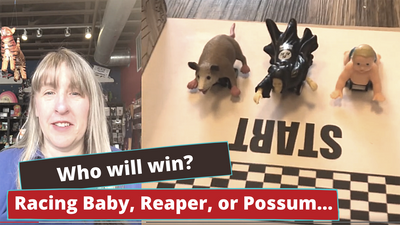 Who will win?  A baby, a possom or a grim reaper???